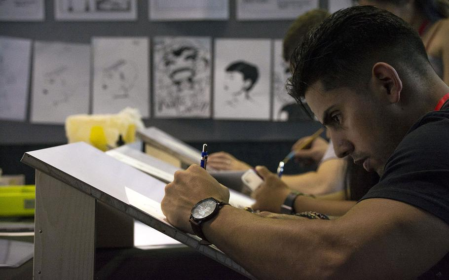 People participate in a drawing contest during Comic Con Okinawa at Camp Foster, Sunday, Oct. 14, 2018.
