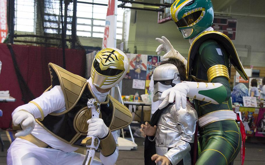 Cosplayers pose for photos during Comic Con Okinawa at Camp Foster, Sunday, Oct. 14, 2018.