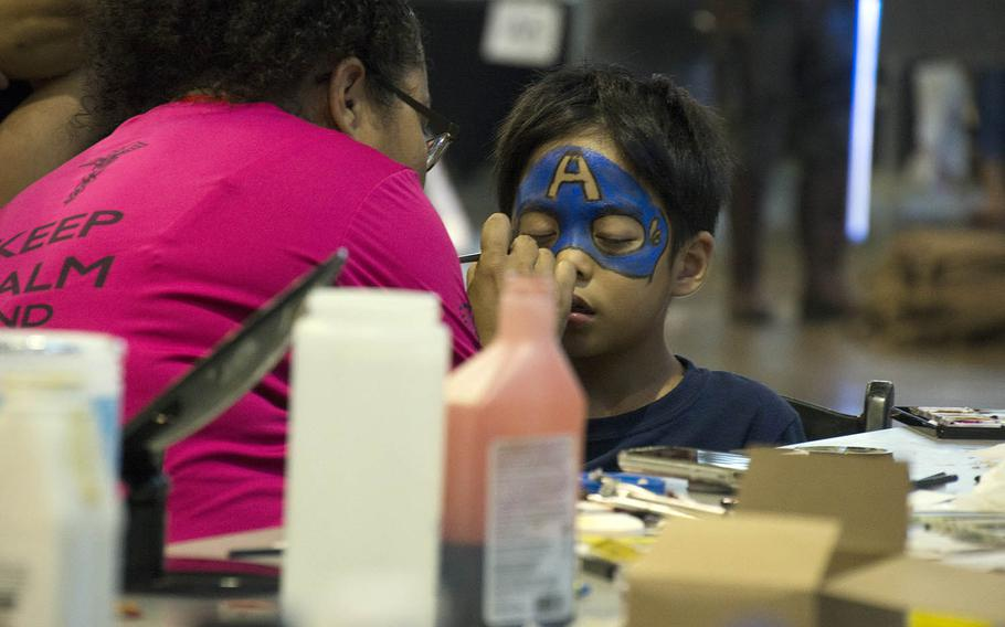A boy gets superhero face paint during Comic Con Okinawa hosted by Marine Corps Community Services at Camp Foster, Okinawa, Sunday, Oct. 14, 2018.