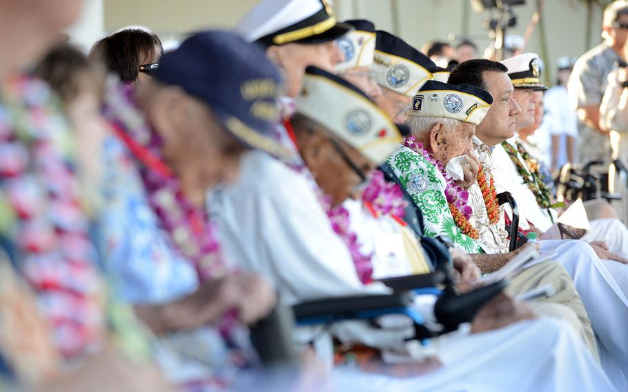 Alfred Benjamin Kameeiamoku Rodrigues, a Pearl Harbor survivor and Hawaii native, wipes his face during the 76th commemoration of the attack on Pearl Harbor at the World War II Valor in the Pacific National Monument in Oahu, Dec. 7, 2017.