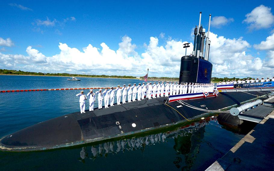 The crew of the fast-attack submarine USS Indiana salute after bringing the ship to life during its commissioning ceremony at Port Canaveral, Fla., Sept. 29, 2018.