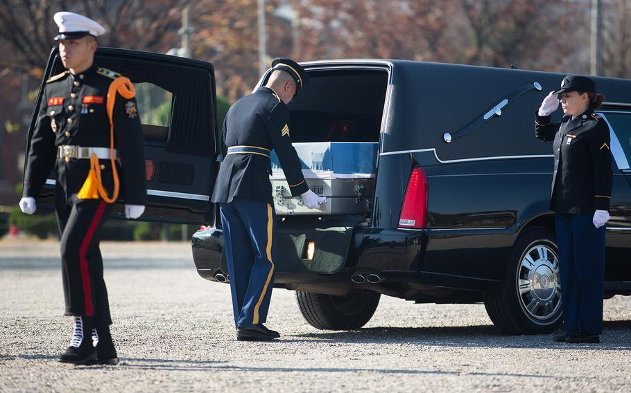 A soldier loads remains from the Korean War onto a hearse at Yongsan Garrison in Seoul, South Korea, Tuesday, Nov. 20, 2018.