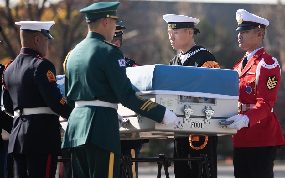 A United Nations Command honor guard carries Korean War remains at Yongsan Garrison in Seoul, South Korea, Tuesday, Nov. 20, 2018.