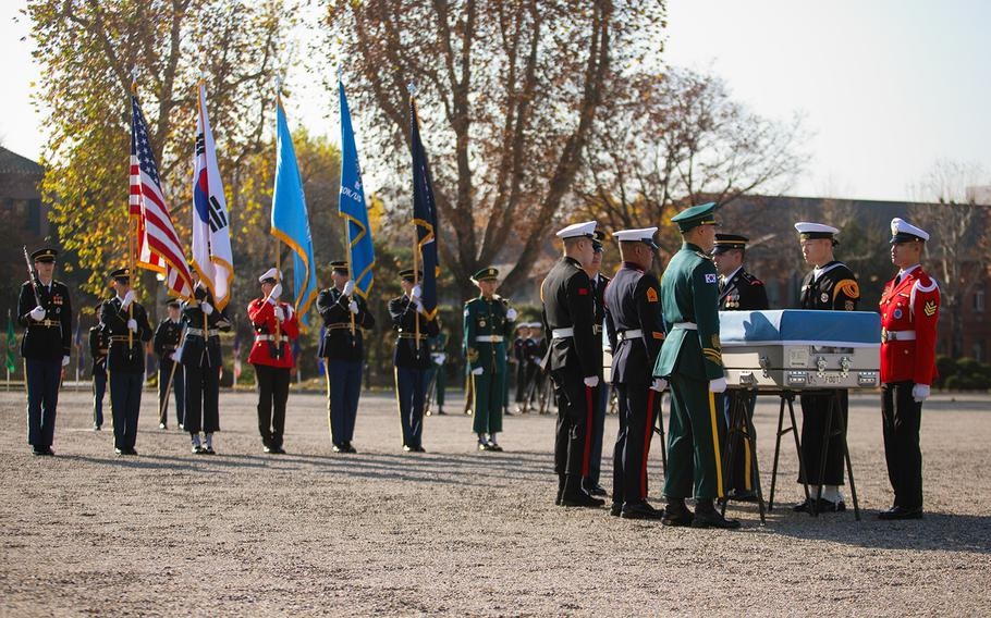A United Nations Command honor guard prepares to repatriate a casket carrying Korean War remains at Yongsang Garrison in Seoul, South Korea, Tuesday, Nov. 20, 2018.