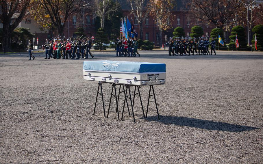 A casket carrying presumed American remains from the Korean War rests at Yongsan Garrison in Seoul, South Korea, Tuesday, Nov. 20, 2018.