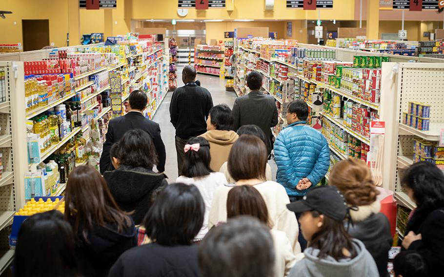 Japanese schoolchildren and their parents tour the commissary at Marine Corps Air Station Iwakuni, Japan, Monday, Jan. 14, 2019, during a community relations tour of the installation.