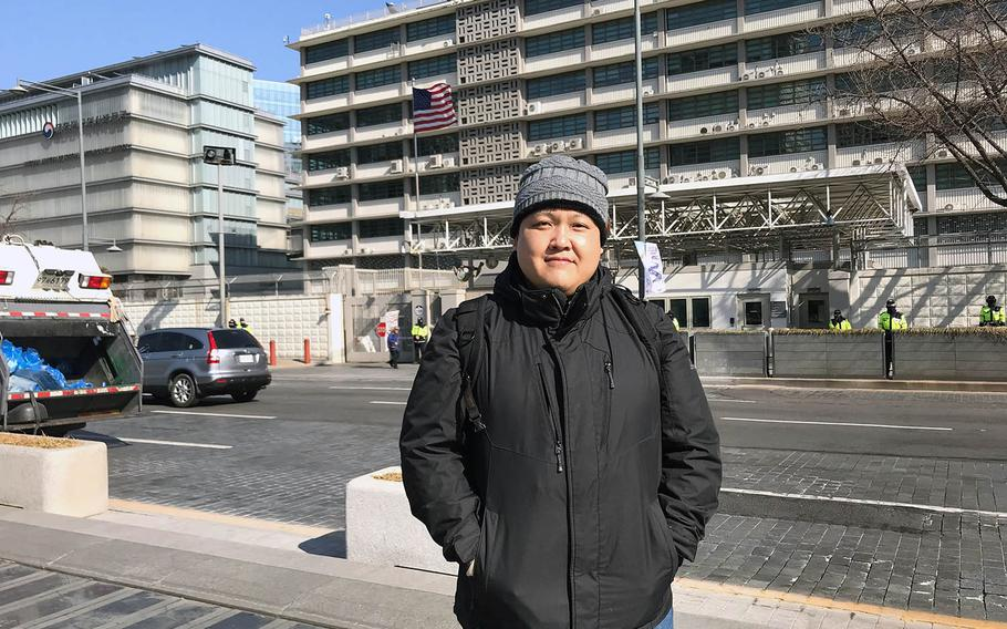 Tong Yi, known as Don to family and friends, poses in front of the U.S. Embassy in Seoul, South Korea, before going to a meeting there to discuss his case, Monday, Feb. 11, 2019.