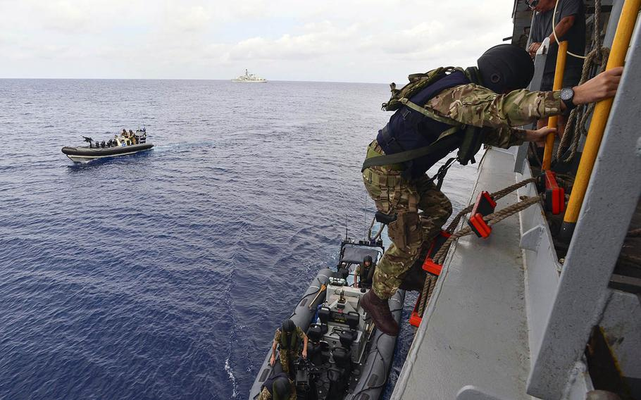 Royal Marine commandos and Royal Navy sailors from the frigate HMS Montrose conduct a search-and-seizure drill aboard the fleet replenishment oiler USNS Guadalupe in the South China Sea on Monday, Feb. 18, 2019.