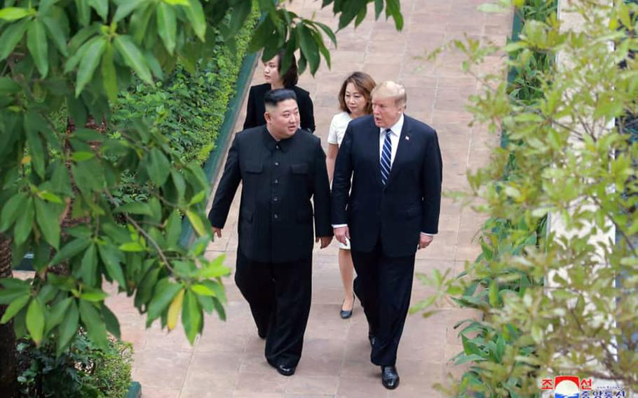 President Donald Trump walks with North Korean leader Kim Jong Un during their second summit in Hanoi, Vietnam, in this photo released by the Korean Central News Agency.