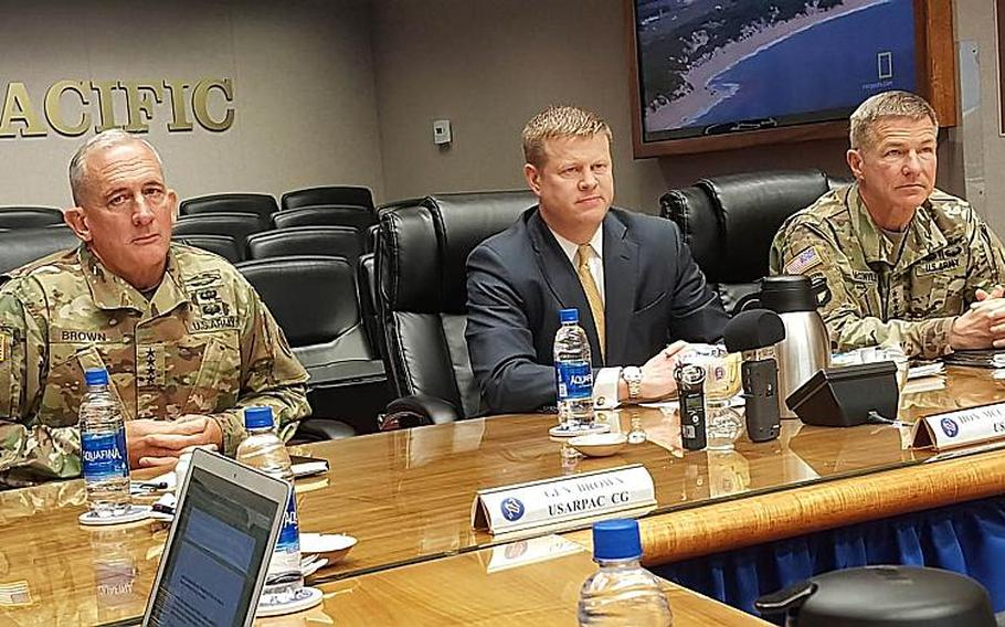 Left to right: Gen. Robert Brown, U.S. Army Pacific commander; Ryan McCarthy, Army under secretary; and Gen. James McConville, vice chief of staff of the Army, speak with reporters at Fort Shafter, Hawaii, Tuesday, March 19, 2019.