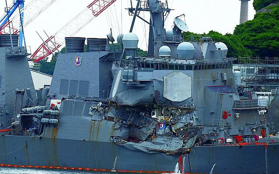 The collision-damaged destroyer USS Fitzgerald is seen at Yokosuka Naval Base, Japan, Sunday, June 17, 2017.