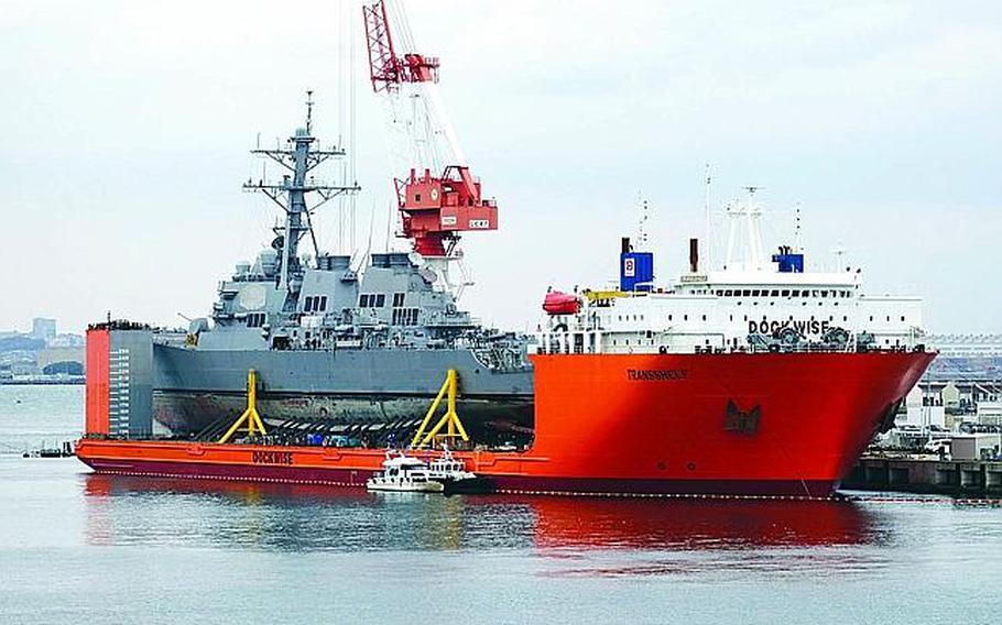 The USS Fitzgerald is seen at Yokosuka Naval Base, Japan, aboard the MV Transshelf, Monday, Nov. 27, 2017.