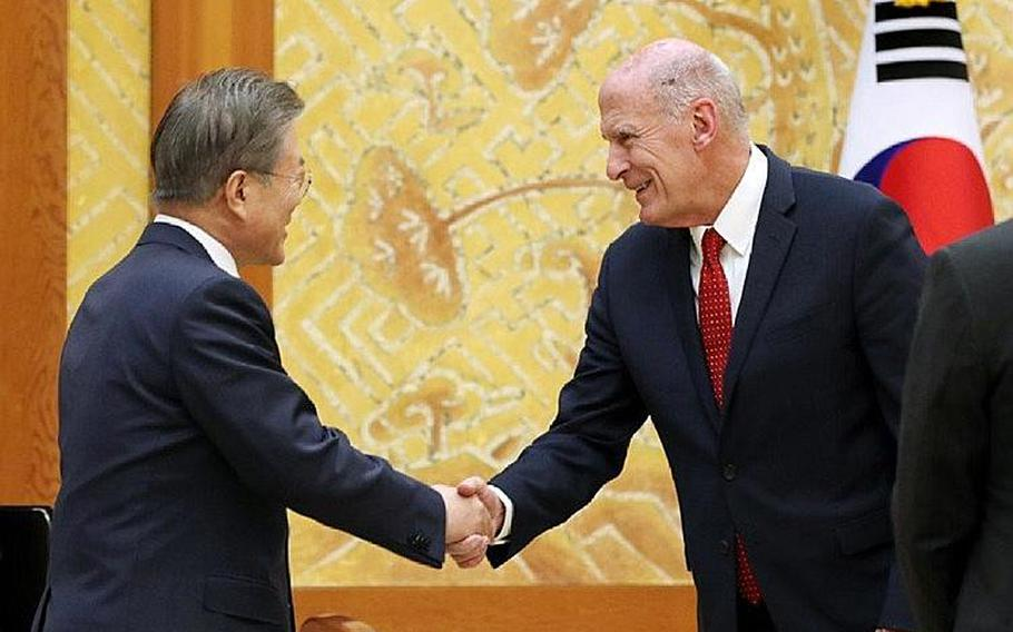 South Korean President Moon Jae-in greets Director of National Intelligence Dan Coats during a meeting in Seoul on Wednesday, March 20, 2019.