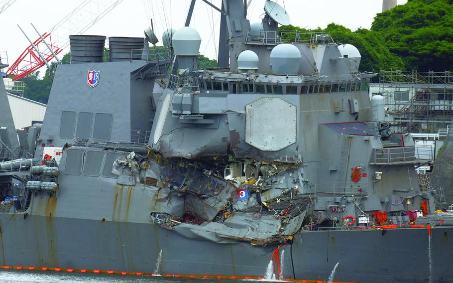The U.S. Navy destroyer USS Fitzgerald is seen following its collision with a merchant ship at Yokosuka Naval Base, Japan, Sunday, June 17, 2017.