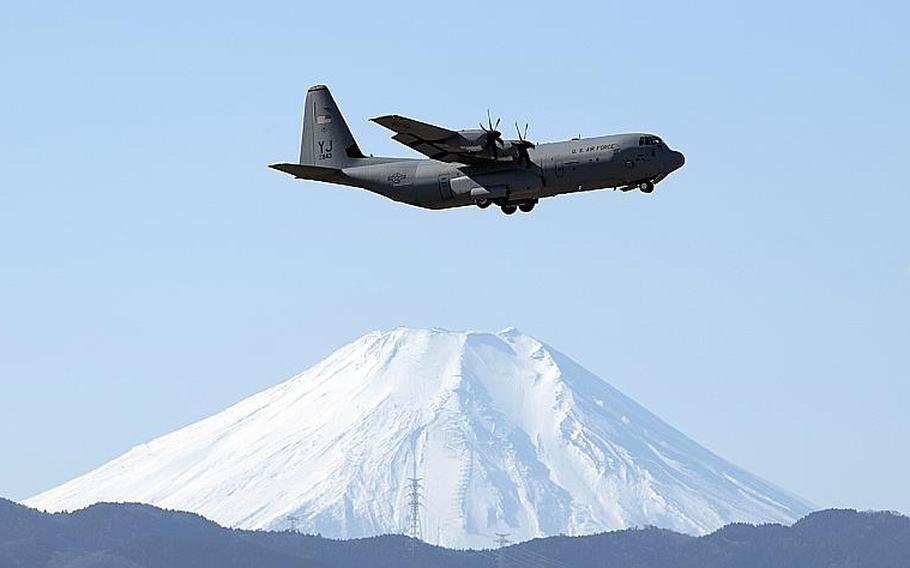 A C-130J Super Hercules assigned to the 36th Airlift Squadron flies over Yokota Air Base, Japan, with Mount Fuji in the background, Jan. 8, 2019.
