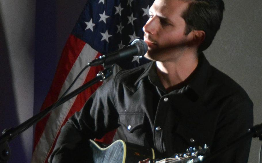 Country music artist Devin Dawson performs at the Tokyo home of Ambassador to Japan William Hagerty on Thursday, March 28, 2019.