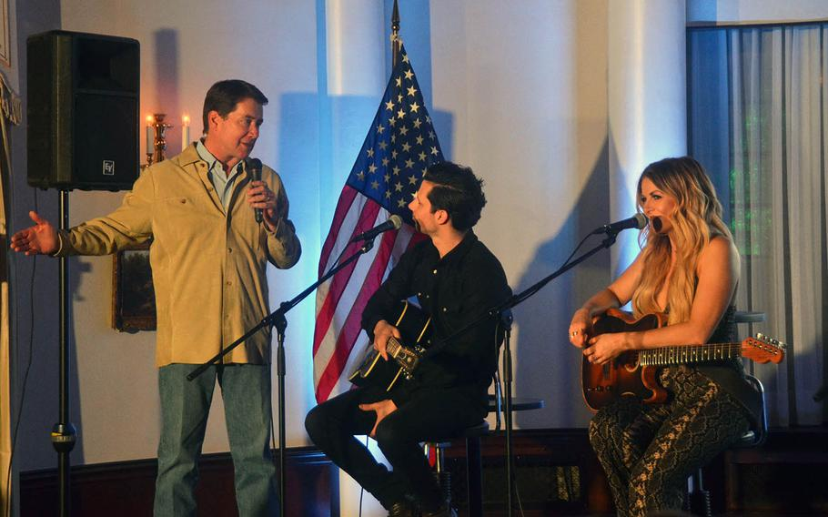 Ambassador to Japan William Hagerty, left, speaks to country music artists Devin Dawson and Lindsay Ell at his home in Tokyo on Thursday, March 28, 2019.