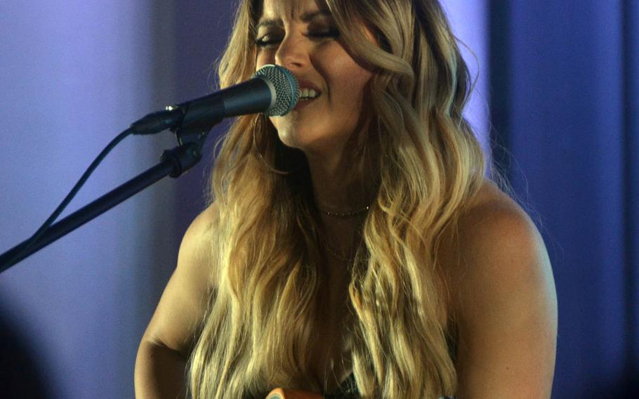 Country music artist Lindsay Ell performs at the Tokyo home of Ambassador to Japan William Hagerty on Thursday, March 28, 2019.