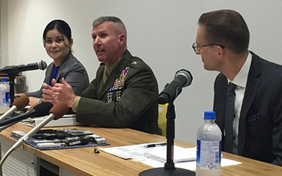 III Marine Expeditionary Force commander Lt. Gen. Eric Smith, center, speaks to reporters in Urasoe, Okinawa, Thursday, March 28, 2019.