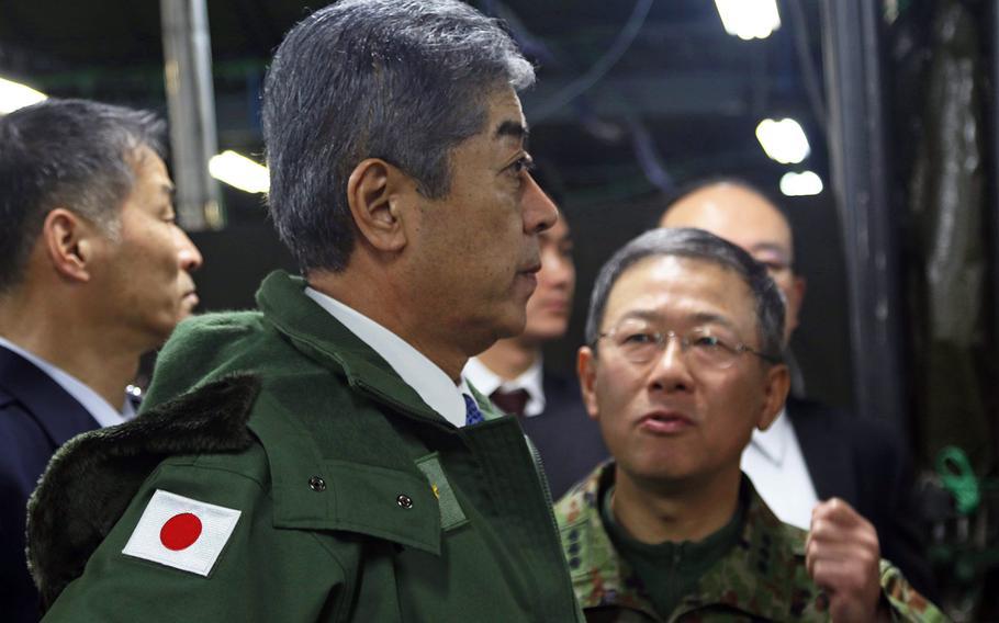 Japanese Defense Minister Takeshi Iwaya tours the command post during Yama Sakura 75 at Camp Higashi-Chitose, Hokkaido, Japan, Dec. 15, 2018.