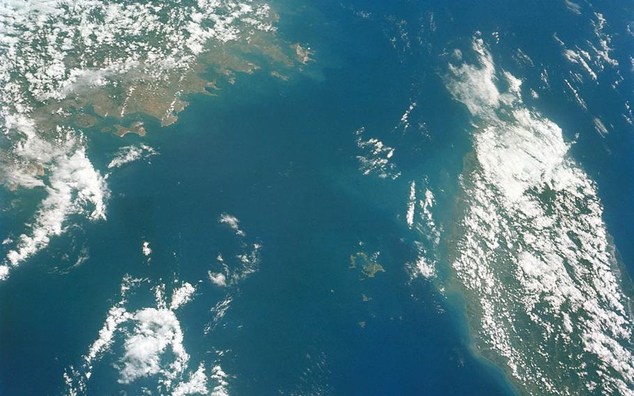 This undated photo taken from space shows the Taiwan Strait between mainland China, at left, and Taiwan.