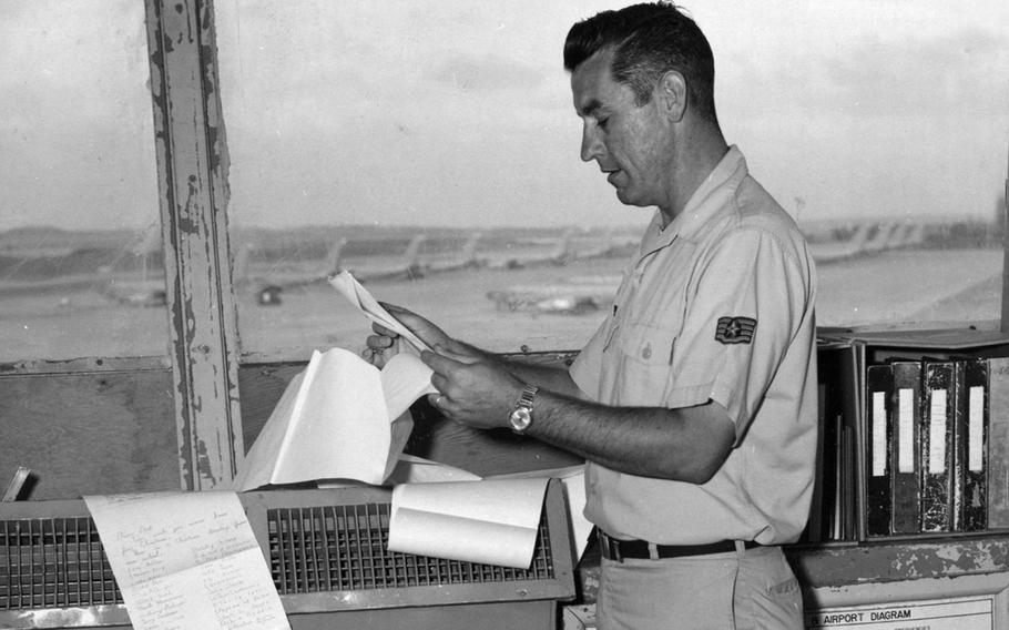 An air traffic controller at Ching Chuan Kang Air Base, Taiwan, reads a 22-foot letter sent by elementary school students in Jacksonville, Fla., in January 1970.