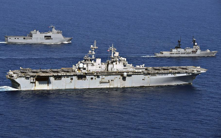 The USS Wasp, center, maneuvers alongside the Philippine navy's BRP Tarlac, left, and BRP Ramon Alcaraz in the South China Sea during the Balikatan exercise on April 5, 2019.