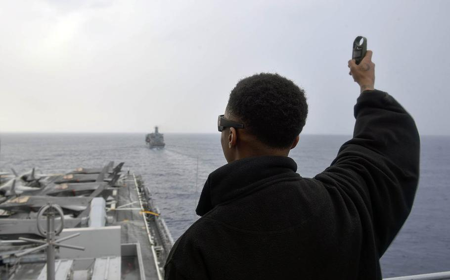 U.S. Navy Airman Braxton Reese, of Jacksonville, Fla., measures wind speed onboard the USS Wasp during a replenishment-at-sea with the  USNS Pecos during the Balikatan exercise in the South China Sea on April 4, 2019.