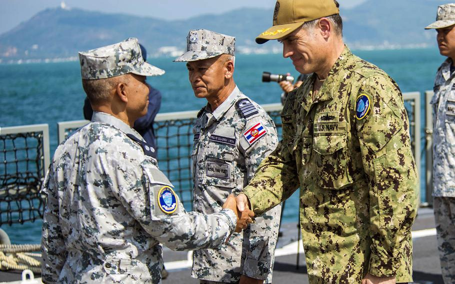 Capt. Matt Jerbi, commodore, Destroyer Squadron 7, right, greets Royal Thai Navy Rear Adm. Kamjorn Charoenkiat during the Guardian Sea opening ceremony in Phuket, Thailand, on Sunday, April 7, 2019.