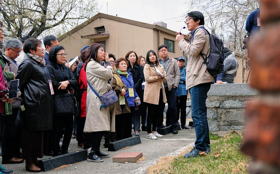 Kim Chun-soo, director of history and culture at Yongsan Cultural Center, describes for visitors the historic Japanese military stockade inside Yongsan Garrison, South Korea, on Tuesday, April 9, 2019.