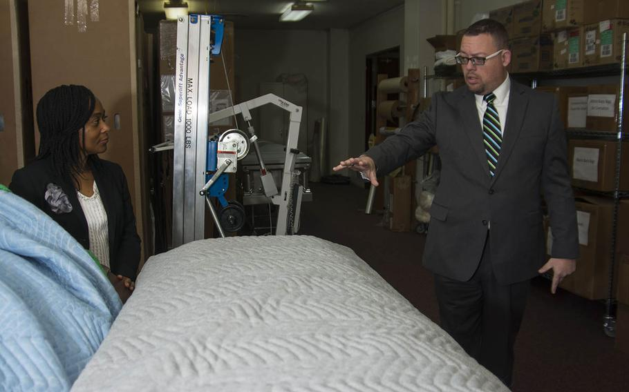 Matthew Metschke, right, director of Pacific Air Forces Western Pacific Regional Mortuary, and assistant director Mable Justice explain the scope of their work during a tour at Yokota Air Base, Japan, Feb. 6, 2019.