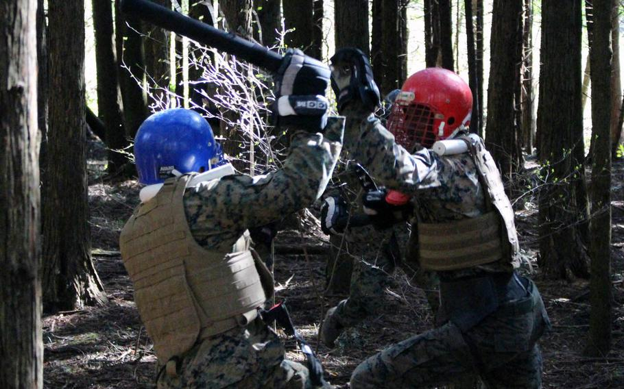 Marines spar during a Marine Corps Martial Arts Instructor Course at Combined Arms Training Center Camp Fuji, Gotemba, Japan, on Wednesday, April 10, 2019.