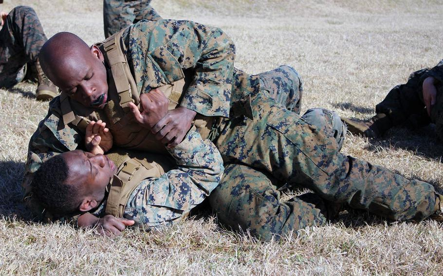 Marines grapple hand-to-hand during martial arts training at Combined Arms Training Center Camp Fuji, Gotemba, Japan, on Wedensday, April 10, 2019.