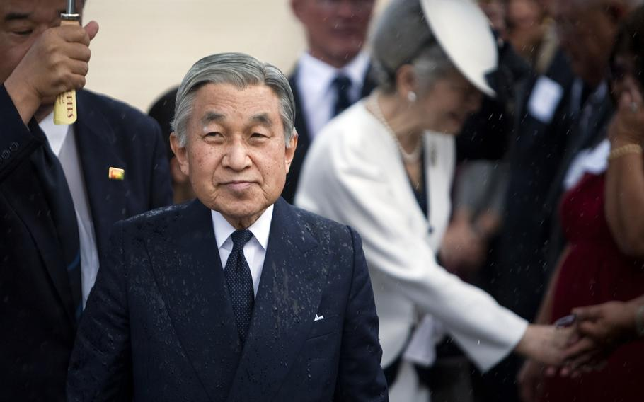 Japanese Emperor Akihito, pictured here in 2009 at the National Memorial Cemetery of the Pacific, is expected to abdicate his throne May 1, 2019. His son, Crown Prince Naruhito, is slated to succeed him.