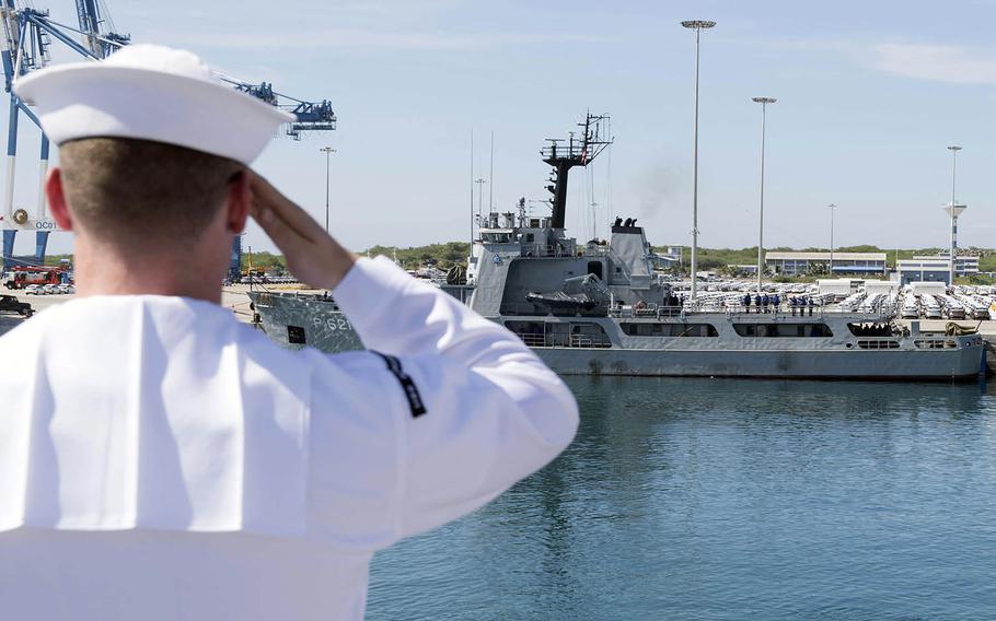 Petty Officer 2nd Class Jacob Crowe salutes the Sri Lankan navy's SLNS Samudura as the USS Spruance pulls into Hambantota, Sri Lanka, April 18, 2019.