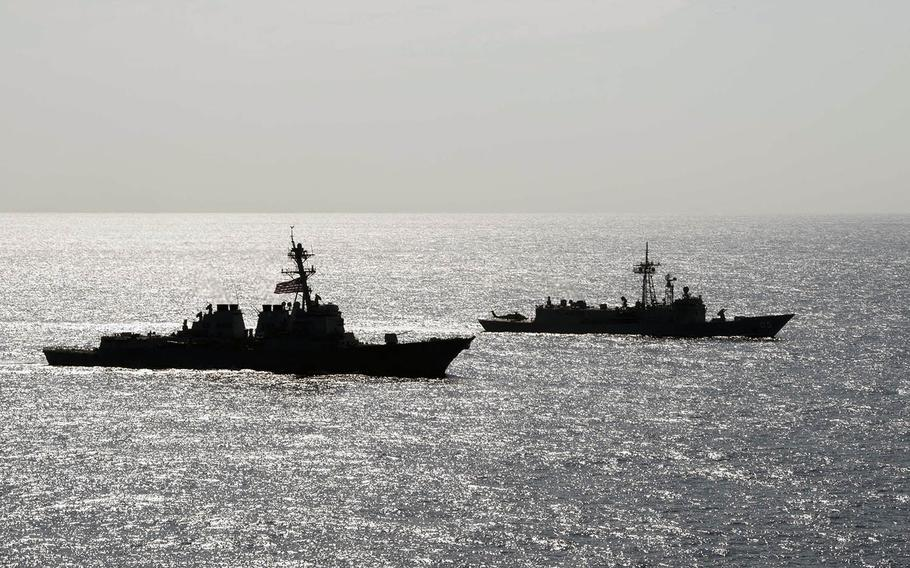The USS Preble and the Australian frigate HMAS Melbourne move in formation on the Philippine Sea on Thursday, April 18, 2019.