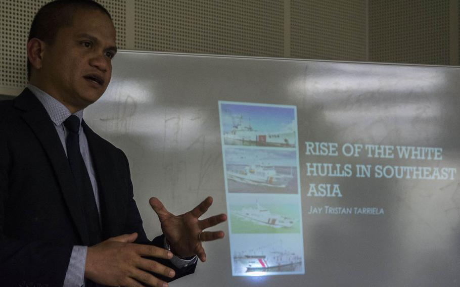 Lt. Cmdr. Jay Tarriela of the Philippine Coast Guard speaks about the increasing numbers and missions of coast guards in the region during a Yokosuka Council on Asia-Pacific Studies meeting in Fussa, Japan, April 18, 2019.