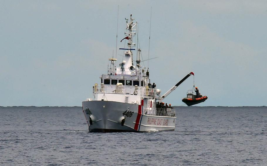 A team of Philippine coast guardsmen ride a rigid-hull inflatable boat during training in September in an undisclosed area.