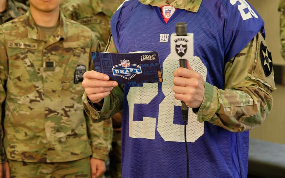 Warrant Officer James Benecke of the 2nd Sustainment Brigade announces the New York Giants' second pick in the 2019 NFL Draft from Camp Humphreys, South Korea, Friday, April 26, 2019.