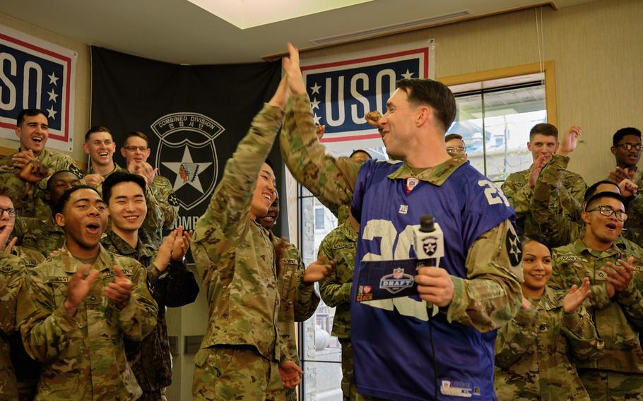 Second Infantry Division soldiers celebrate after announcing the 17th pick in the first round of the 2019 NFL Draft at Camp Humphreys, South Korea, Friday, April 26, 2019.