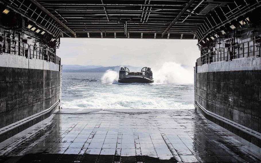 A landing craft air cushion approaches the well deck of USS New Orleans somewhere in the Pacific Ocean, March 15, 2019.
