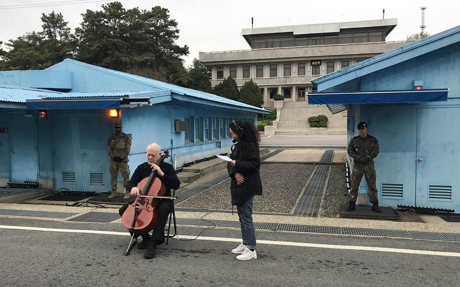 American cellist Lynn Harrell performs in front of the spot on the Military Demarcation Line where the South and North Korean leaders met during the first inter-Korean summit. Several musicians performed to celebrate the summit's first anniversary in the truce village of Panmunjom, Saturday, April 27, 2019.