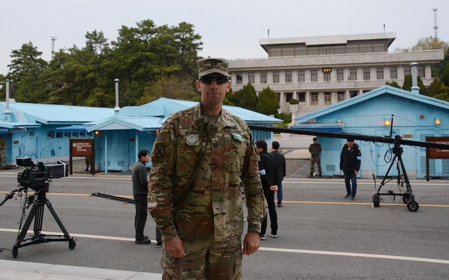 Army Capt. Matthew Sturgis of the United Nations Command Security Battalion poses during celebrations of the first anniversary of the first inter-Korean summit in the truce village of Panmunjom, Saturday, April 27, 2019.