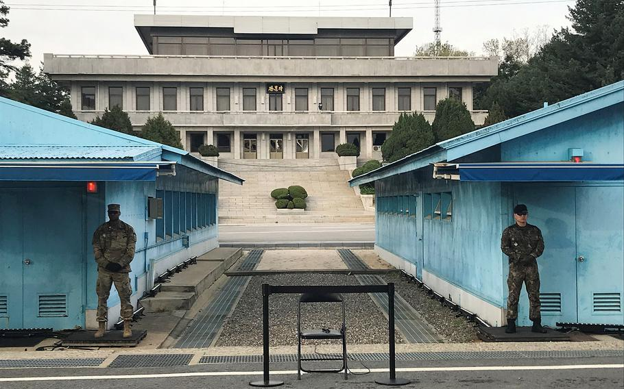 United Nations Command soldiers stand guard as an empty chair waits for a performer in the truce village of Panmunjom during a celebration to mark the first anniversary of the first summit between North and South Korea, Saturday, April 27, 2019.