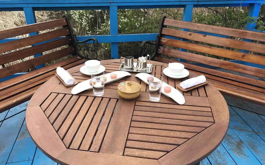 The table on the foot bridge where the North and South Korean leaders held a private chat was laid out with macarons and tea cups to recreate the scene for celebrations of the first anniversary of the first inter-Korean summit, Saturday, April 27, 2019.