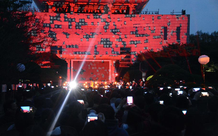 South Koreans and foreign dignitaries were treated to a light show in the truce village of Panmunjom during a celebration of the first anniversary of the first inter-Korean summit, Saturday, April 27, 2019.