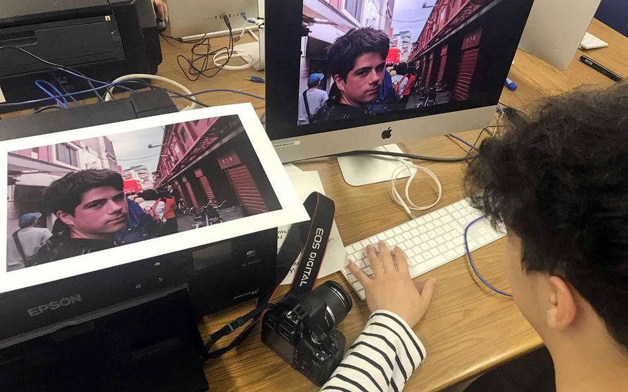Ethan Martin, a senior at Humphreys High School in South Korea, edits a photograph during the Far East Film and Creative Expressions Festival in Tokyo, May 2, 2019.