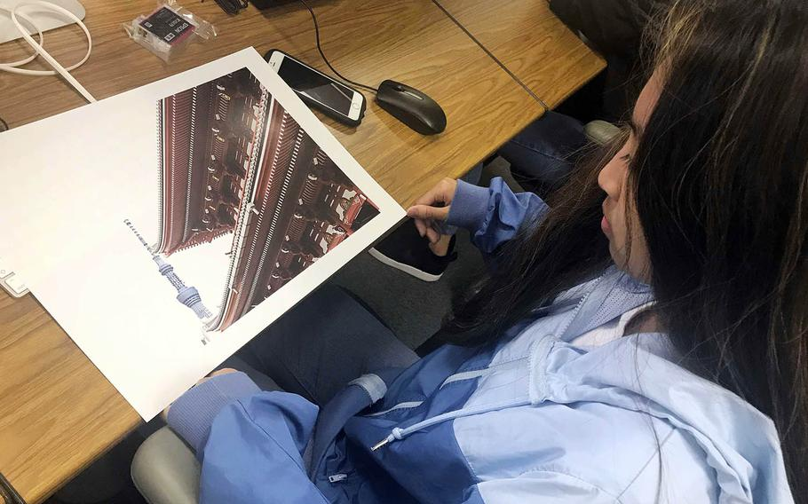 Skylabelle Jimenez, a junior at Nile C. Kinnick High School on Yokosuka Naval Base in Japan, looks over her photograph during the Far East Film and Creative Expressions Festival in Tokyo, May 2, 2019.