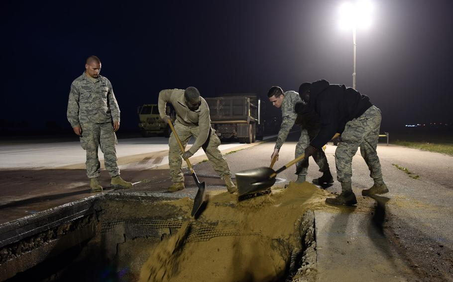 Airmen from the 8th Civil Engineer Squadron work to repair a sinkhole in the runway at Kunsan Air Base, South Korea, May 1, 2019.