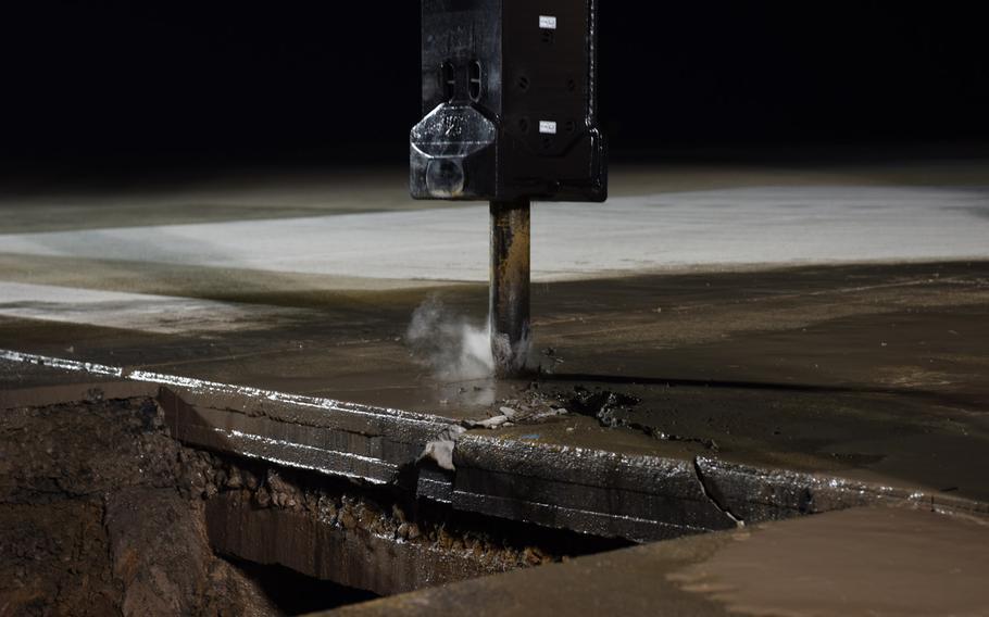 An excavator-mounted hydraulic jackhammer is used during a runway repair at Kunsan Air Base, South Korea, May 1, 2019.